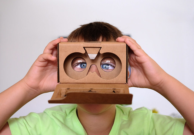 A man using google cardboard how to watch vr videos without headset