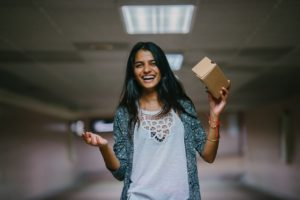Woman holding a brown cardboard box