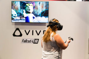 woman in blonde wearing vr while standing